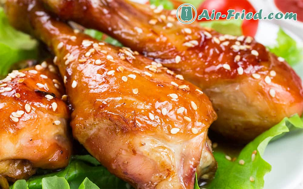 Chicken drumsticks in an air fryer with sweet and sour glaze